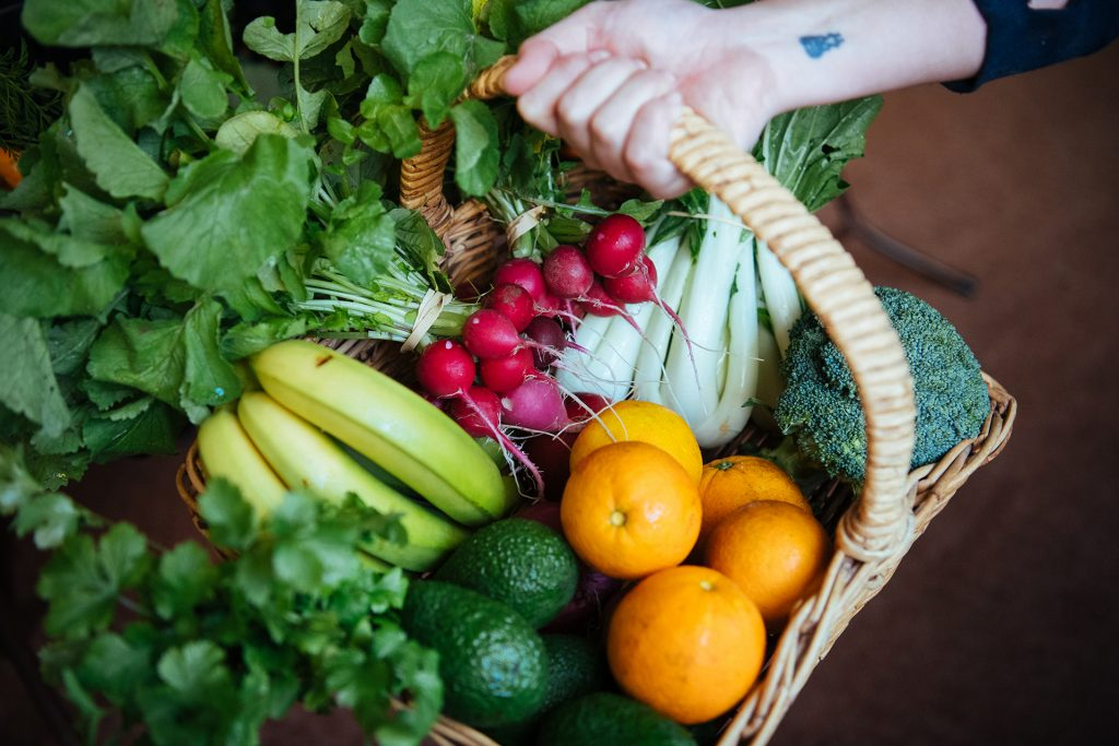 Delicious looking basket of fresh fruit and vegetables.